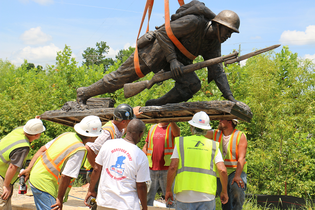 Workers carrying soldier statue