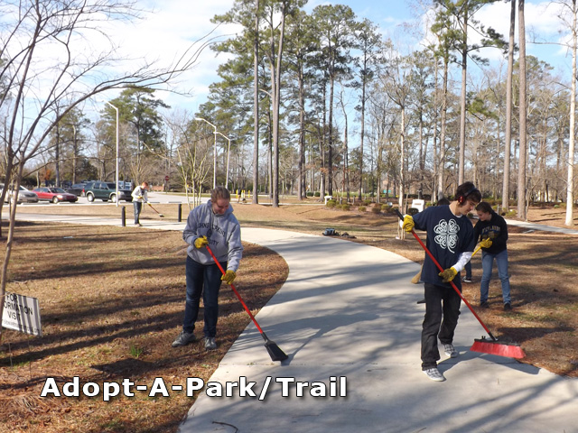 Kids sweeping a park trail
