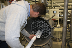 A city staff members replaces the filters for large particle removal