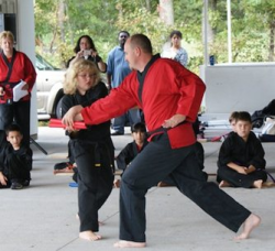 Self defense instructor teaching a student.